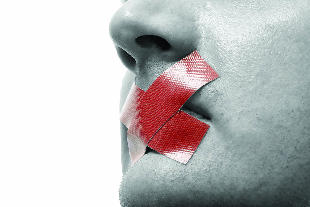 Censored Man with red tape on his mouth. Colorkey. Isolated on white.