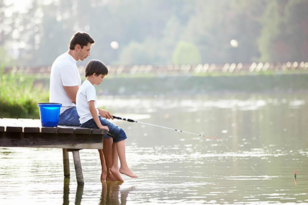 Man and boy fishing on the lake
